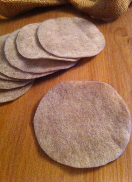 "You'll also want to cut out felt circles whatever diameter you'd like your flowers to be.  Mine are probably about 3""-4"" in diameter.  I used the lid to a container jar as my template."