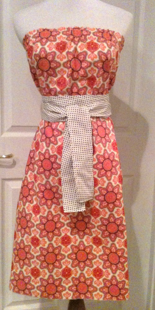 All dresses will be this style.  Some will have a matching sash if no coordinating fabric is available.