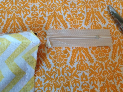 Oh girl - you're almost done!  clip your corners and trim off the excess zipper ends.  Turn right side out.