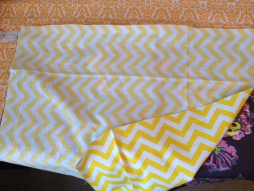 Now put your other pillow piece on top, wrong side up, and line it up with the zipper.  Then sew to the zipper.