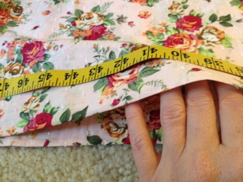 Fold your fabric over, lining up the folds. Measure where you'll cut.